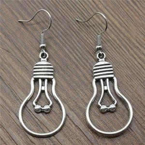 silver color incandescent light bulb earrings